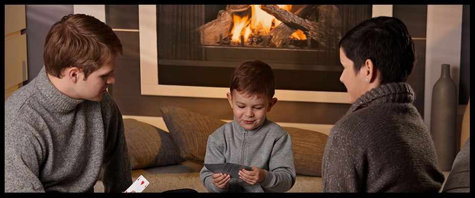 Heat Tech Heating & Ventilation | Family by fireplace